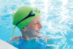 Portrait of smile little cute child in the swimming pool. Portrait of little cute child in the swimming pool.Focussed athlete before the start Royalty Free Stock Image