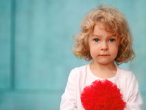 Portrait of a little cute curly girl outdoors Royalty Free Stock Photography