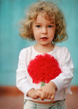 Portrait of a little cute curly girl outdoors royalty free stock photos