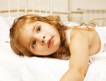 Portrait of little cute girl in bed at home close up Stock Images