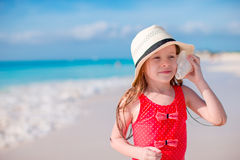 Portrait of little cute girl with a big seashell Royalty Free Stock Images
