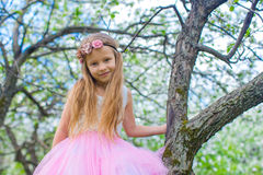 Portrait of little cute girl in blossoming apple Royalty Free Stock Images