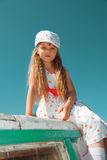 Portrait of little cute girl enjoying playing on boat on a hot s Stock Photography