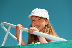 Portrait of little cute girl enjoying playing on boat Stock Photo