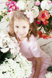 Portrait of little cute girl with flowers Royalty Free Stock Photo