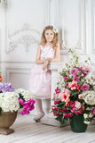Portrait of little cute girl with flowers Stock Photo