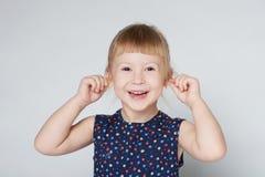 Portrait of little cute girl grimacing Stock Photos