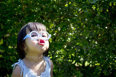 Portrait of little cute girl having good time Stock Photos