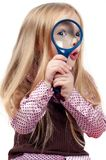 Girl with magnifying glass over white background Stock Photo