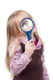 Portrait of little cute girl with long hair with magnifying glass Royalty Free Stock Photography