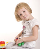 Portrait of little cute girl painting and playing, isolated on white background Stock Photo