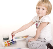 Portrait of little cute girl painting and playing, isolated on white background Royalty Free Stock Photo