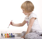 Portrait of little cute girl painting and playing, isolated on white background Royalty Free Stock Photography