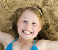 Portrait of little cute girl on sand having fun Stock Photography