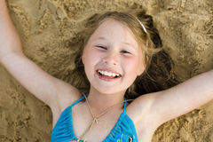 Portrait of little cute girl on sand having fun Royalty Free Stock Photos