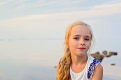 Portrait of little cute girl on sunset Stock Photos