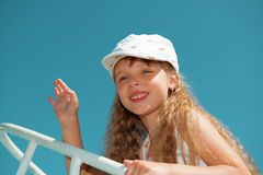 Portrait of little cute girl waving goodbye on a boat Stock Photography