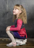 Portrait of little cute girl writing on the blackboard. Close up Royalty Free Stock Photography