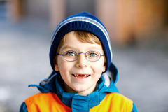 Portrait of little cute school kid boy with glasses royalty free stock photos
