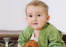 Portrait of little cute smiling boy with his toy Royalty Free Stock Photos
