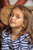 Portrait of a little dark-haired girl Stock Photo
