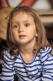 Portrait of a little dark-haired girl Stock Image