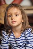 Portrait of a little dark-haired girl Stock Image