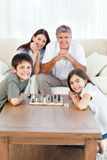 Portrait of a little family in their living room Royalty Free Stock Photography