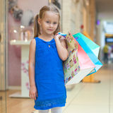 Portrait of little fashion girl holding shopping Royalty Free Stock Images