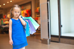 Portrait of little fashion girl holding shopping Stock Photo