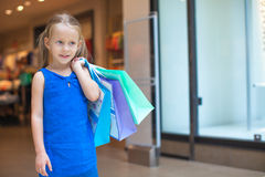 Portrait of little fashion girl holding shopping Stock Images