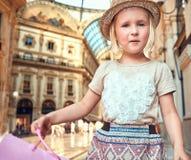 Portrait of little fashion monger in Galleria Vittorio Emanuele Stock Photo