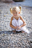 Portrait of a little gir on the beach Stock Images