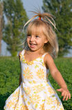 Portrait of the little girl. In the field Royalty Free Stock Image