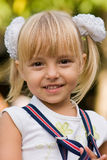 Portrait of the little girl. Portrait of little beautiful girl wearing suspenders Royalty Free Stock Photography