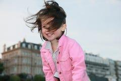 Portrait of little girl. Portrait of joyful girl in windy weather Stock Photos