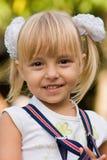 Portrait of the little girl. Portrait of little beautiful girl wearing suspenders Royalty Free Stock Photo