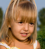 Portrait of the little girl. In the field Stock Photos