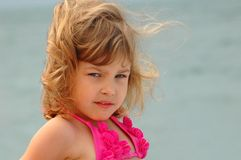 Portrait of the little girl. On a beach Stock Photo