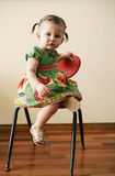 Portrait of little girl. A portrait of a little girl sitting in a chair Stock Photography