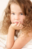 Portrait of a little girl. Little girl looking pensively Royalty Free Stock Images
