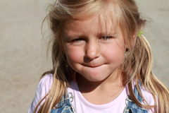 Portrait of a little girl. With gray background royalty free stock image