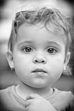 Portrait of little girl. Black and white portrait of a little girl with big eyes and blonde curly hair Stock Photography