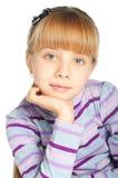 Portrait of little girl. On white background Stock Photo
