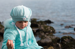 Portrait of a little girl . Little girl sitting on a river beach .Rhine,Germany Royalty Free Stock Images