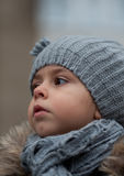 Portrait of little girl. Girl in hat and scarf. Portrait of serious little girl Royalty Free Stock Image