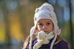 Portrait of little girl. With knit hat and scarf Royalty Free Stock Photo