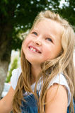 Portrait of a little girl. Portrait of a happy little girl outdoors Royalty Free Stock Image