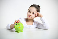 Portrait of little girl with. Piggy bank Stock Photography