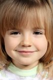 Portrait of the little girl. The portrait of the little girl which smiles Stock Image